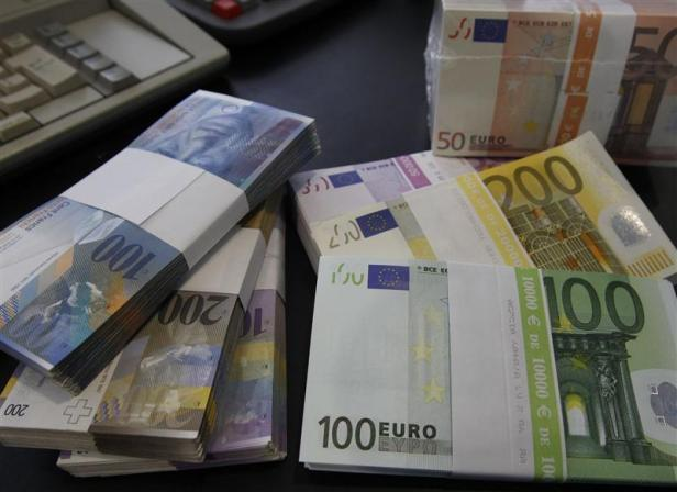File photo of stacks of Swiss franc Euro and U.S. dollar banknotes