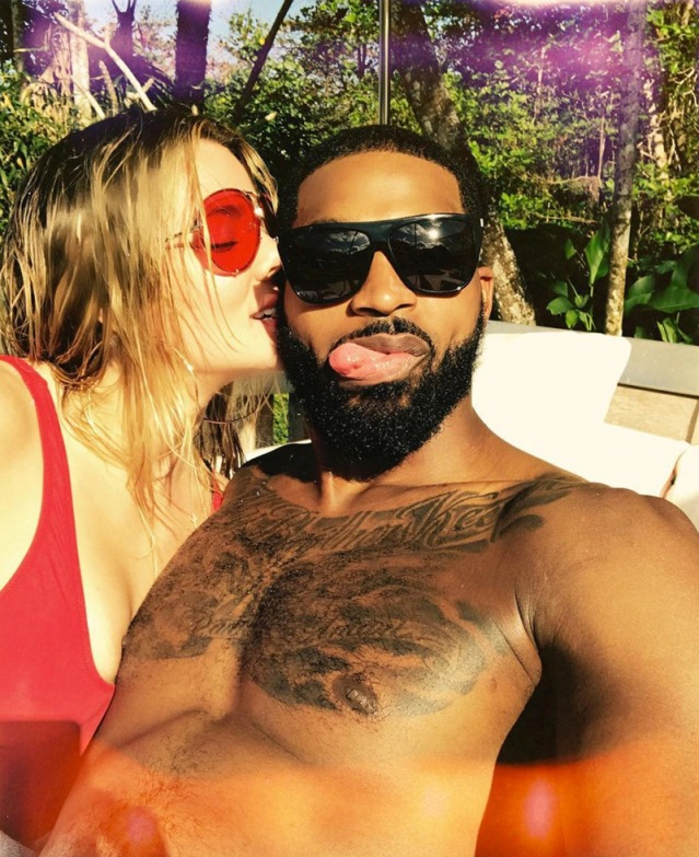 khloe-kardashian-and-tristan-thompson-lounge-by-pool-gallery.jpg
