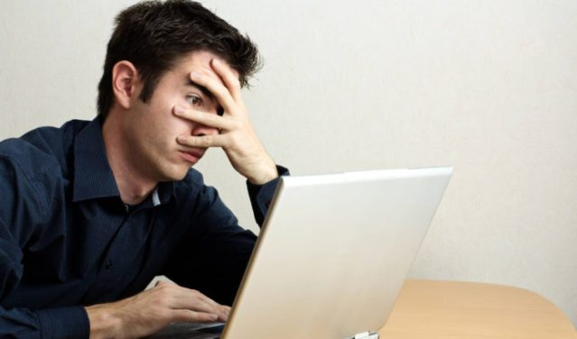 guy-at-laptop-hand-face-1086x628-696x410.jpg
