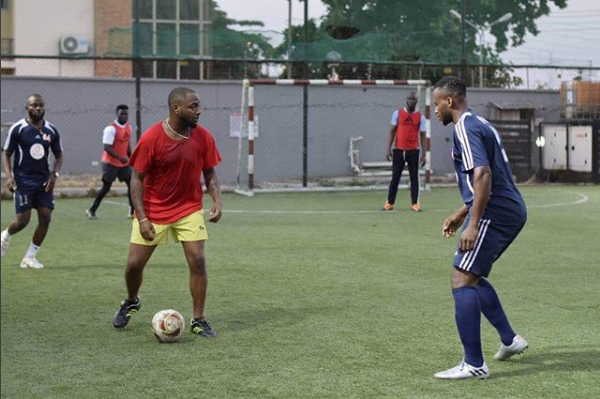 Davido Playing soccer with his road Manager (See Photos)