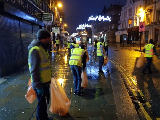 Young Muslims In The UK Clean Up Street After New Year's Eve Celebrations